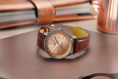 04_navitimer-automatic-35-with-a-copper-colored-dial-and-a-brown-alligator-leather-strap-1.jpg