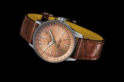 05_navitimer-automatic-35-with-a-copper-colored-dial-and-a-brown-alligator-leather-strap-1.jpg