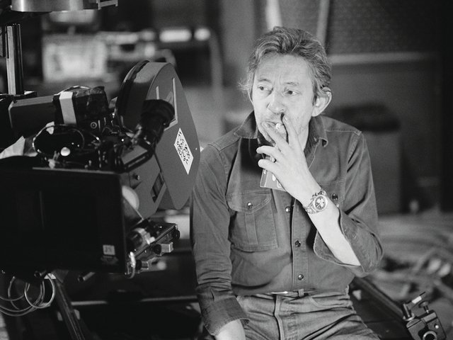French singer Serge Gainsbourg from circa 1980s, wearing his Navitimer reference 81600 on its special bracelet made of platinum and smoking a cigarette