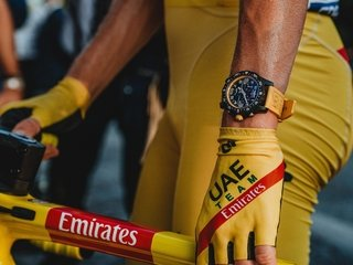 Tadej Pogačar Wins Tour de France in Stunning Come-from-Behind Performance: 21-Year-Old Wears Yellow Jersey and a Yellow Breitling Endurance Pro on Top of the Podium in Paris